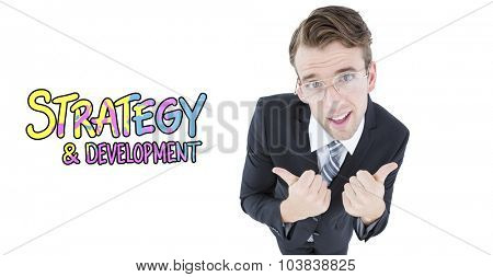 Geeky businessman with thumbs up against strategy and development