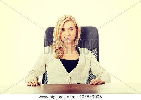 Happy woman sitting at the desk.