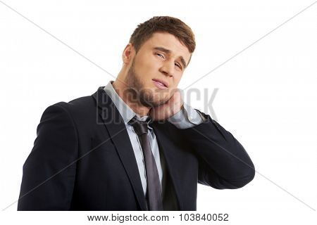 Handsome businessman suffering from toothache.