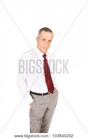 Confident businessman with hands in pockets.