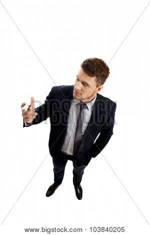 Young handsome businessman holding big pencil.