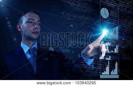 Young businessman pressing high tech icon on media screen