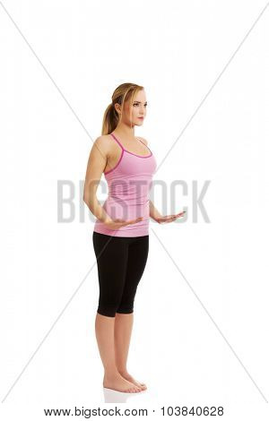 Young active woman doing aerobic exercise.