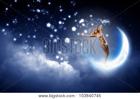 Hot young woman in white bikini dancing on moon