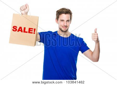 Man with shopping bag and thumb up and showing a word sale!
