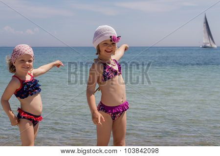 Funny Little Girls (sisters) On The Beach At Sailfish Point.