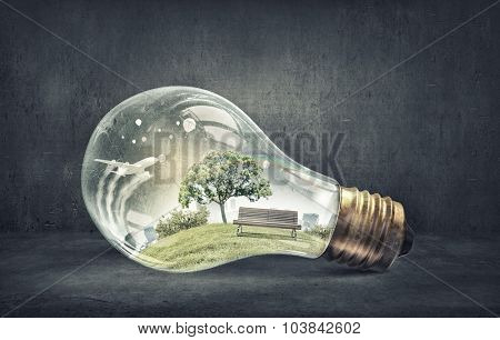 Eco life and energy saving concept in glass light bulb