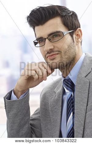 Portrait of daydreaming businessman, looking away.