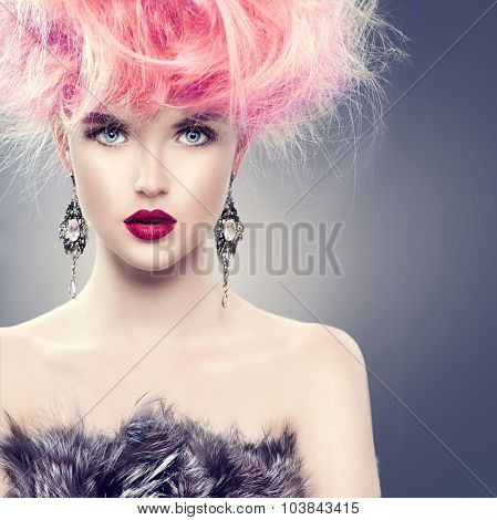 High Fashion Model Girl with Updo hairstyle and stylish makeup. Beauty woman with glamour hairdo hair style and accessories. Beauty Lady in fur coat portrait