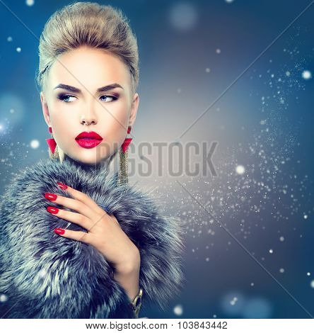 Winter Woman in Luxury Fur Coat. Beauty Fashion Model Girl in Blue Fox Fur Coat. Perfect Makeup and accessories. Beautiful Luxury Winter Lady