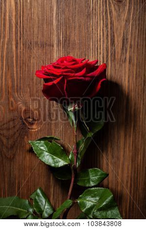 Red rose on a wooden