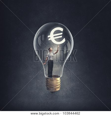 Woman holding luminous idea inside light bulb
