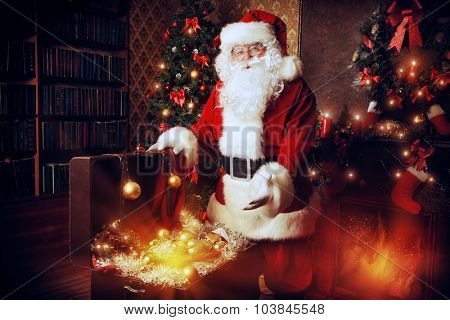 Old Santa Claus with Christmas gifts at home. Christmas decoration.