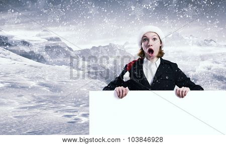 Shocked Santa woman with blank banner. Place for your text