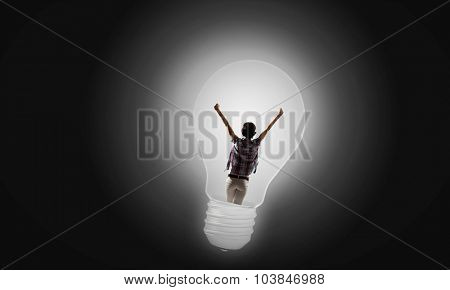 Back view of girl inside of light bulb