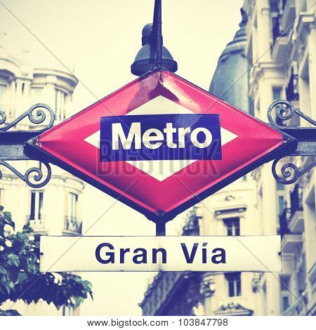 Metro sign in Madrid, Gran Via station. Instagram style filtered image