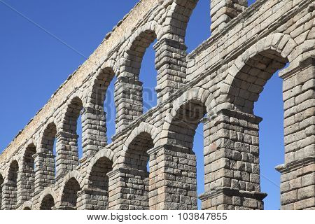 Perspective of ancient roman aqueduct in Segovia, Spain
