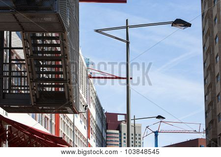 Modern City Buildings And Lampposts