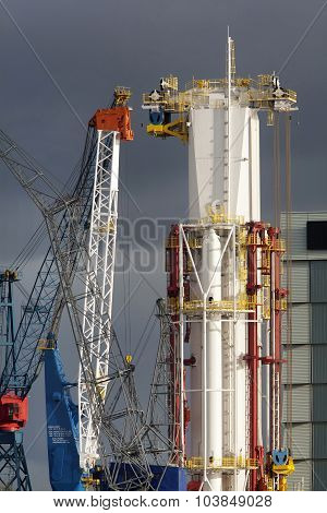 Drilling Mast Of A New Drill Ship Surrounded By Cranes