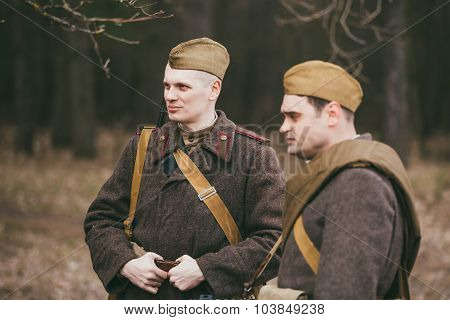 Two young unidentified re-enactors dressed as Soviet soldiers in