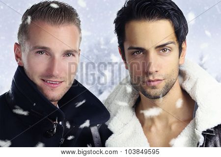 two handsome men during a snowy day