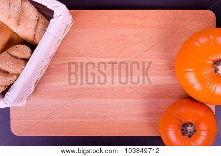 Fresh bread and pumpkin in a rustic style. Text