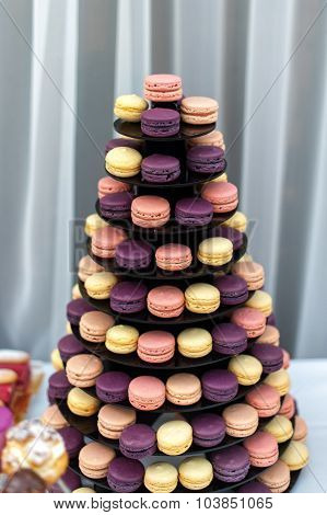 Tasty colorful macaroons on the plate
