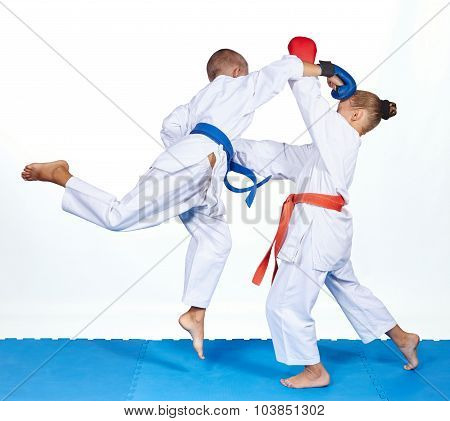 Blow in jump in perfoming an athlete with a blue belt