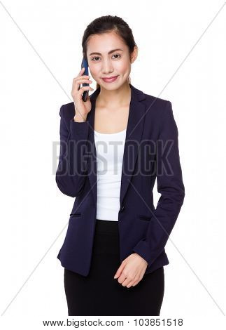 Asian Young businesswoman talk to mobile phone
