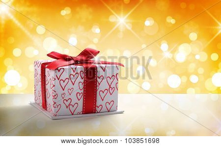 White Gift Box With Bow And Hearts Golden Bokeh Front