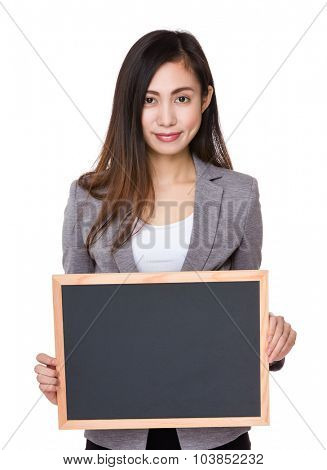 Asian Young businesswoman show with the blackboard