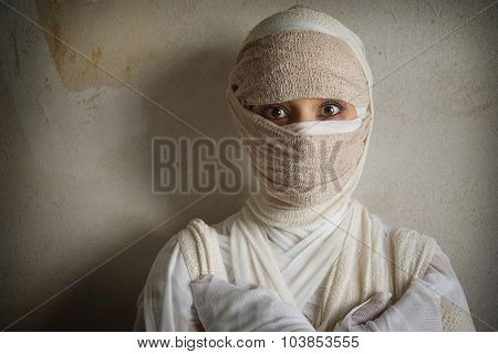 woman wrapped in bandages
