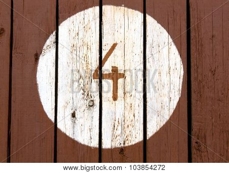 Number Four On Painted Wooden Wall.