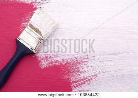 Paintbrush With White Paint Painting Over Pink