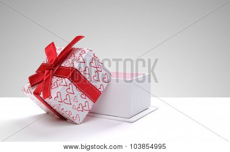 Open Gift Box With Hearts Printed With Grey Background Front