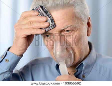 elderly man with flu inhalation