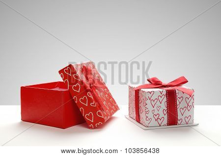 Two Gift Boxes With Hearts Printed With Grey Background Front