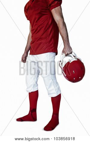 Rugby player posing with helmet over white background