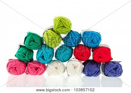 Many balls of colorful wool isolated over white background