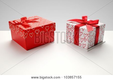 Two Gift Boxes With Hearts Printed With Grey Background Top