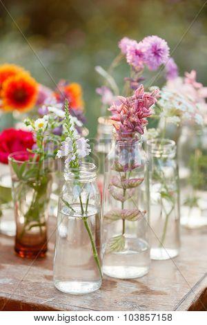 nice flowers in the bottles