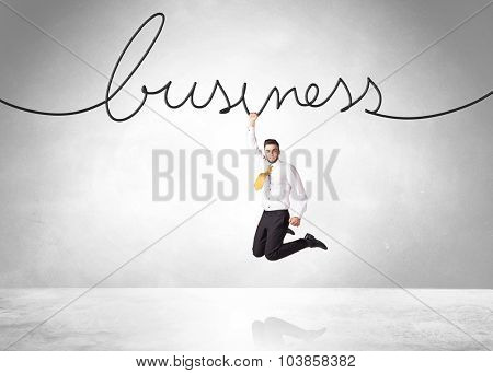 Businessman hanging on a business rope