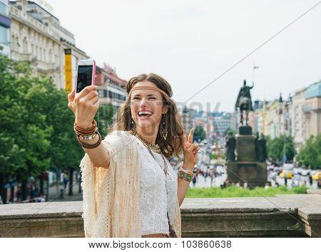 Hippie Woman Showing Victory Gesture And Making Selfie In Prague