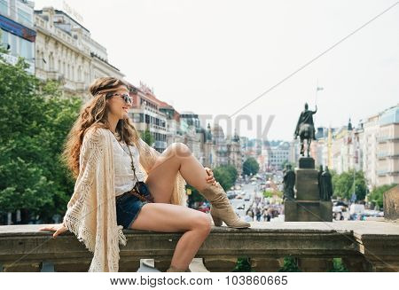 Trendy Hippie Woman Sitting On Parapet On Wenceslas Square
