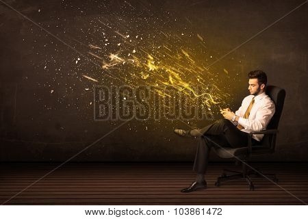 Businessman with tablet and energy explosion on background concept