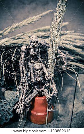 Intimate Skeleton Friends in Halloween Wooden Background Texture