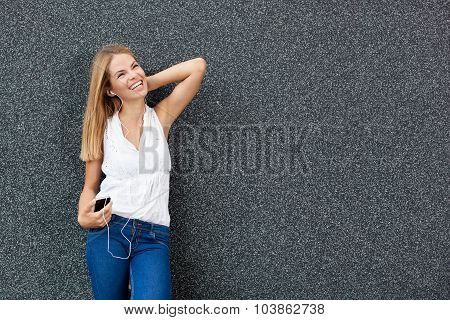 Young Woman Listening To Music On The Smart Phone