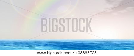 High resolution concept conceptual sea or ocean water waves and sky cloudscape exotic or paradise background banner with a rainbow