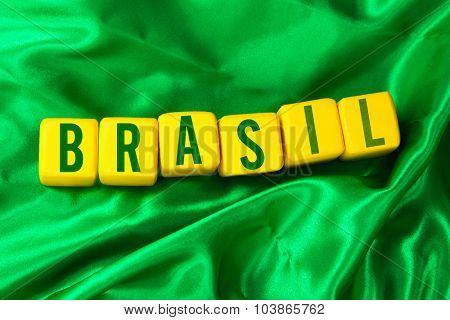 Brasil written on yellow cube on green background