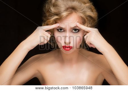 face of beautiful woman pointing at  her forehead